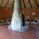 Boma lounge with fireplace, Munga Eco Lodge